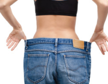 Woman with jeans after diet | Johns Creek Family Medicine
