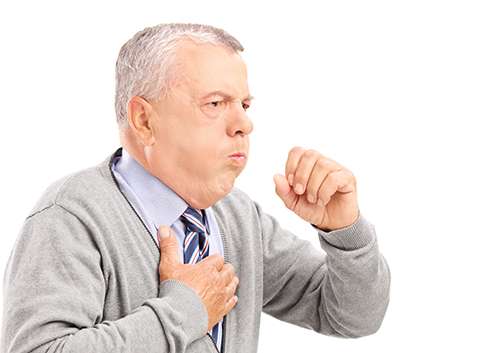 photo of senior citizen coughing and holding his chest