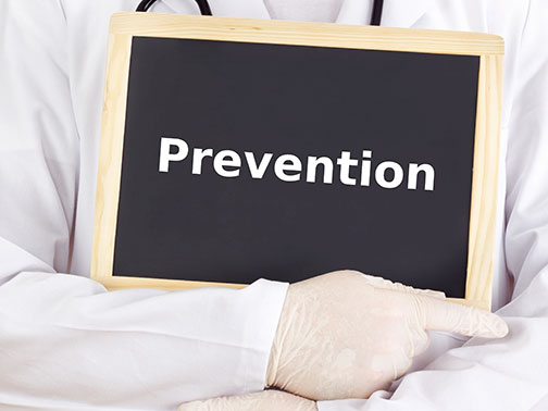 photo if doctor holding a chalkboard with the words prevention