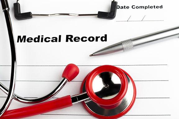 photo os a stethoscope on a medical record